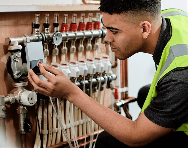 young man doing electrical work